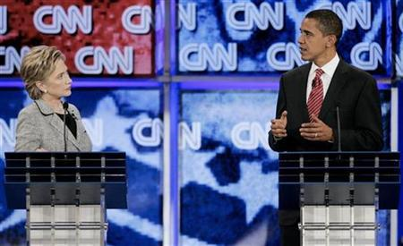 Senator Barack Obama (D-IL) (R) gestures as Senator Hillary Clinton (D-NY) listens at the CNN/Nevada Democratic Party debate in at the University of Nevada Las Vegas (UNLV) in Las Vegas, Nevada November 15, 2007. REUTERS/Steve Marcus