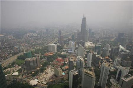 A view of haze-blanketed Kuala Lumpur October 5, 2006. An ethnic Indian in Malaysia is using an audacious strategy to highlight the plight of his mostly impoverished community by suing Britain, the country's former colonial ruler, for $4 trillion. REUTERS/Bazuki Muhammad