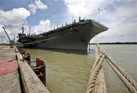The USS Kitty Hawk carrier is anchored at Malaysia's West Port in Port Klang, outside Kuala Lumpur, August 28, 2007. China refused permission for the USS Kitty Hawk and accompanying vessels to visit Hong Kong for a long-planned Thanksgiving holiday visit -- and then changed its mind. REUTERS/Bazuki Muhammad