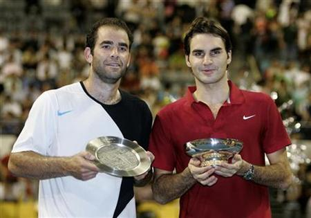 Roger Federer (R) of Switzerland poses with Pete Sampras of U.S. after their tennis invitational exhibition match in Kuala Lumpur November 22, 2007. REUTERS/Zainal Abd Halim