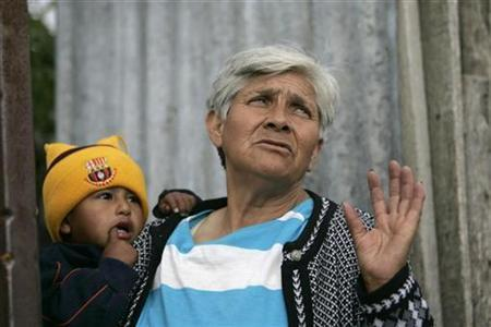 Gloria Sanchez, a mother of five who collects scrap metal for a living, gestures during an interview in Quito's crime-ridden slum of Pisuli April 11, 2007. REUTERS/Guillermo Granja