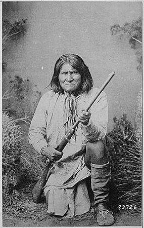 Geronimo is seen kneeling with a rifle in a photo from the U.S. National Archives. A Springfield rifle owned by the famed Apache warrior Geronimo fetched $100,000 (48,500 pounds) during an auction of Wild West guns and weapons that brought in more than $1 million. It is unknown if the rifle pictured is the one auctioned. REUTERS/National Archives/Handout