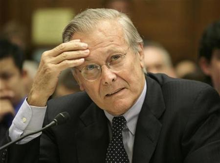 Former U.S. Secretary of Defense Donald Rumsfeld listens to testimony during a House Oversight and Government Reform Committee hearing on what military leaders knew about the combat death in Afghanistan of U.S. Army Ranger and former football star Pat Tillman, in Washington, August 1, 2007. REUTERS/Yuri Gripas