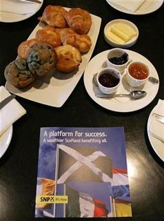 Scottish National Party (SNP) leaflet lies on a table during a business breakfast briefing in Edinburgh April 20, 2007. A third of office workers would rather grab a few minutes extra sleep than breakfast, according to a survey that estimated poor eating habits were costing companies dearly in terms of lost productivity. REUTERS/David Moir