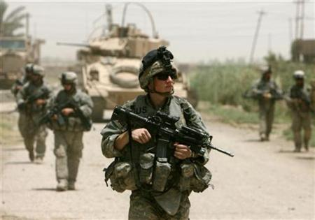 U.S. soldiers patrol in Baquba June 26, 2007. Overall U.S. troop levels in Iraq will fall by about 5,000 when a combat brigade completes its pullout from the country's volatile Diyala province next month, U.S. military officials said on Saturday. REUTERS/Goran Tomasevic