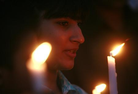 A girl takes part in candlelight protest against media curbs imposed after emergency rule in Karachi on November 24, 2007. REUTERS/Athar Hussain