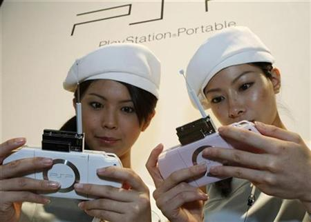 Models demonstrate Sony's new PlayStation Portable (PSP-2000 model) at the Tokyo Game Show in Chiba, east of Tokyo September 20, 2007. Sony Corp said sales in Japan of the new version of its PlayStation Portable (PSP) game gear reached 1 million units in the two months since its launch, hitting the 1 million mark at a quicker pace than the original model. REUTERS/Issei Kato