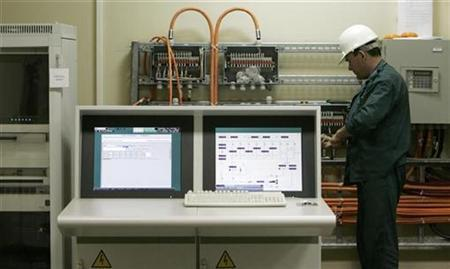 A Russian technician works inside the nuclear power plant in Bushehr, about 1,215 km (755 miles) south of Tehran April 3, 2007. REUTERS/Raheb Homavandi