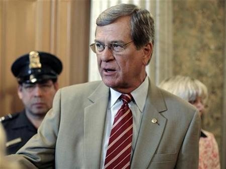 File phot shows Sen. Trent Lott talking with journalists after voting on the U.S. Troop Readiness, Veterans' Health And Iraq Accountability Act on Capitol Hill in Washington April 26, 2007. Lott, the second-ranking Republican in the Senate, will announce he is retiring this year, congressional sources said on Monday. REUTERS/Yuri Gripas