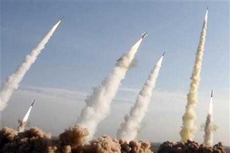 Iran's Revolutionary Guards fire missiles during a war game in a desert near the holy city of Qom, southeast of Tehran, November 2, 2006. Iran has built a new missile able to hit targets 2,000 km (1,250 miles) away, the Iranian defense minister said on Tuesday, matching the range of another missile in the Islamic Republic's arsenal, the Shabab-3. REUTERS/Fars News