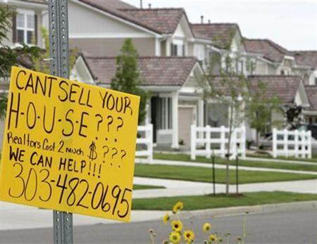 A sign offering house-selling assistance is pictured in the Green Valley Ranch development in Denver, July 26, 2007. Housing and credit troubles took more of a toll on the U.S. economy as prices on pre-owned single-family homes tumbled in the third quarter and consumer confidence in November sank to a two-year low, reports on Tuesday showed. REUTERS/Rick Wilking