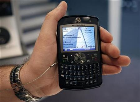 A hostess holds the Motorola Q9 mobile at the 3GSM World Congress in Barcelona, February 15, 2007. REUTERS/Albert Gea