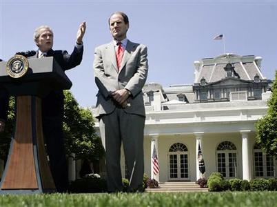 President Bush speaks from the Rose Garden as Al Hubbard, Director of the National Economic Council, looks on, April 28, 2006. Hubbard plans to the leave the Bush administration by the end of this year, a U.S. official said. REUTERS/Jason Reed
