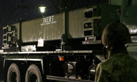 The Patriot Advanced Capability-3 (PAC-3) missiles' canister for training is seen on a military vehicle as a member of the Japan Air Self-Defense Force (JASDF) stands nearby at Iruma Air Base in Sayama, north of Tokyo, in this March 30, 2007 file photo. REUTERS/Kiyoshi Ota/Files