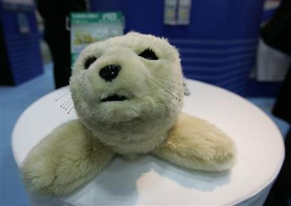 A furry robotic seal called ''Palo'' is pictured at the International Robot Exhibition in Tokyo November 28, 2007. The robot seal, which can learn its name and react to touch, is designed to help elderly people avoid loneliness and develop connections with others by interacting and talking to the robot. REUTERS/Michael Caronna