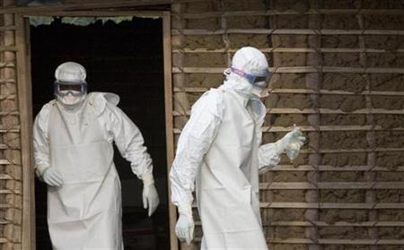 Health workers don protective suits during an operation at an Ebola isolation center in the Democratic Republic of Congo. A new strain of the deadly Ebola virus has infected 51 people and killed 16 in an area of Uganda near the border with Democratic Republic of Congo, U.S. and Ugandan health officials said on Thursday. REUTERS/Chris Black/WHO/Handout