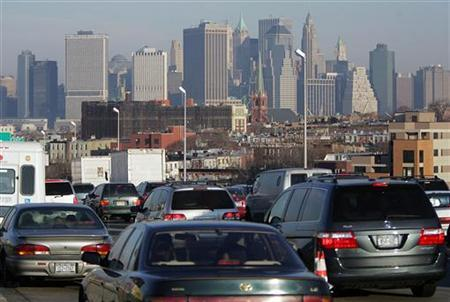 Traffic crawls towards Manhattan in a file photo. U.S. citizens will not have to drive less or read in the dark to slash greenhouse gas emissions by 2030, but they will have to buy more efficient cars and appliances, a report from two business groups said on Thursday. REUTERS/Seth Wenig