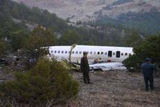 <p>Обломки лайнера MD-83 компании AtlasJet Airline, потерпевшего крушение в горах турецкой провинции Испарта 30 ноября 2007 года. Турецкий авиалайнер потерпел крушение в центральной части страны в пятницу; все 56 человек на борту погибли. (REUTERS/Anatolian)</p>