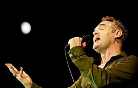 Singer Morrissey, former frontman of The Smiths, performs under the moonlight at an outdoor concert in Zagreb, Croatia, July 6, 2006. REUTERS/Nikola Solic