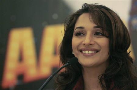 Bollywood actress Madhuri Dixit smiles during a news conference to promote her new movie ''Aaja Nachle,''  ''Come in New Delhi, November 27, 2007. REUTERS/Vijay Mathur