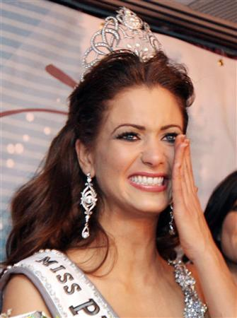 Miss Puerto Rico Universe 2007 beauty pageant winner Ingrid Marie Rivera, from Dorado, reacts with tears during the post-contest news conference at the Center of Performing Arts in San Juan in this November 23, 2007 file photo. Police probing allegations that someone put pepper spray on Rivera's clothing said Saturday they would investigate whether anyone lied to them after tests found no traces of the substance on the woman's belongings. REUTERS/Stringer/Files