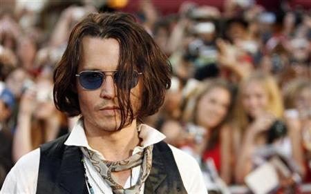 Cast member Johnny Depp attends the premiere of ''Pirates of the Caribbean: At World's End'' at Disneyland in Anaheim, California May 19, 2007. REUTERS/Mario Anzuoni
