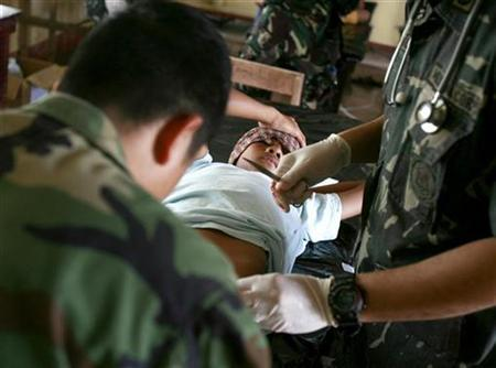 A man receives a free circumcision on the island of Jolo, southern Philippines March 3, 2007. Circumcision may reduce a man's risk of infection with the AIDS virus by up to 60 percent if he is an African, but it does not appear to help American men of color, U.S. researchers reported on Monday. REUTERS/Darren Whiteside