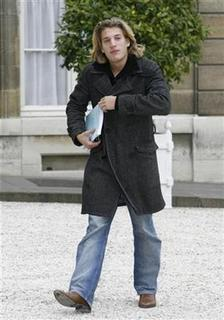 Jean Sarkozy, son of France's President Nicolas Sarkozy, walks across the courtyard at the Elysee Palace in Paris October 25, 2007. REUTERS/John Schults