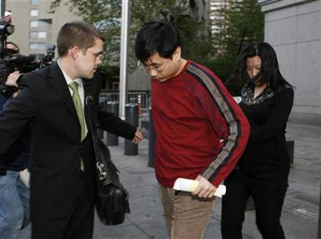 Jennifer Wang (R), a former Morgan Stanley financial analyst, and husband Ruopian Chen (C), a former ING analyst, are escorted by their lawyer as they exit the federal courthouse in New York, May 10, 2007. Wang and Chen were sentenced to a year and half each on Tuesday for insider trading. REUTERS/Lucas Jackson