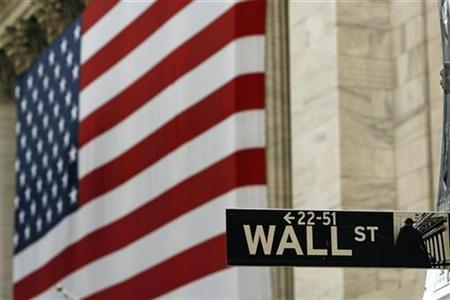 A street sign is seen in front of an American flag hanging on the front of the New York Stock Exchange August 9, 2007. REUTERS/Lucas Jackson