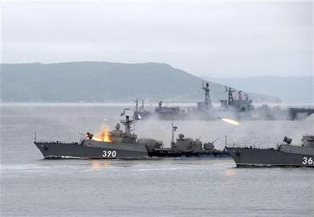 Russian warships open fire during a presentation during Navy Day celebrations off the coast of the far eastern city of Vladivostok July 29, 2007. Russia's navy will start sorties in the Atlantic Ocean and the Mediterranean as part of a drive to boost Russia's military presence on the world's oceans, Defence Minister Anatoly Serdyukov said on Wednesday. REUTERS/Yuri Maltsev