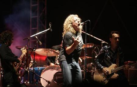 In tshis file photo musician Robert Plant (C), formerly of Led Zeppelin, performs at the main stage during the Exit music festival in the Serbian town of Novi Sad July 12, 2007. The songs remain the same and so will the passion when fans from around the world gather to see Led Zeppelin, one of rock music's most influential bands, reunite for a one-off gig on Monday. REUTERS/Marko Djurica