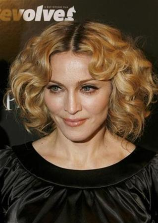 Madonna arrives to attend a Cinema Society screening of the film ''Revolver'' in New York December 2, 2007. Madonna's record label has denied reports that her new album will be called ''Licorice'' and will come out in late April. REUTERS/Lucas Jackson