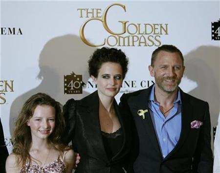 Cast members, from L-R, Dakota Blue Richards, French actress Eva Green and British actor Daniel Craig pose during a photocall for U.S. director Chris Weitz's film ''The Golden Compass'' at the 60th Cannes Film Festival May 21, 2007. ''The Golden Compass,'' a costly fantasy starring Nicole Kidman and Daniel Craig, got off to a slow start at the North American box office and will likely fall short of opening-weekend expectations. REUTERS/Yves Herman