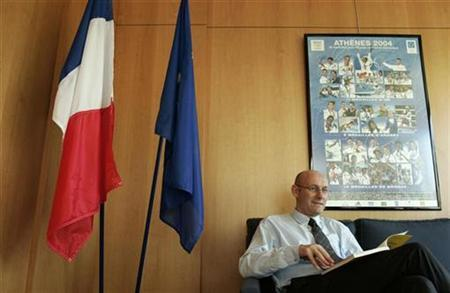 Bernard Laporte, France's sports minister, poses for photographers in his office at the Sport Ministry in Paris October 30, 2007. France plan to bid for the 2016 European football championship, Laporte said on Tuesday. REUTERS/Benoit Tessier