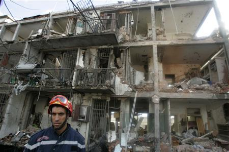 A rescue worker stands at the site of a bomb blast at U.N. offices in the Hydra district of Algiers December 11, 2007. REUTERS/ LOUAFI LARBI