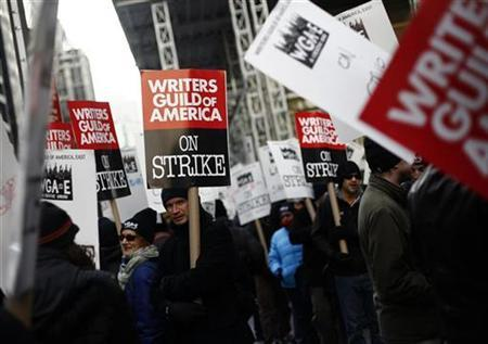 Supporters and members of the Writers Guild of America picket outside the News Corp building in New York December 4, 2007. Hollywood studios have suggested all along that striking writers will be sadly surprised when they discover the high cost of their six-week-old strike. REUTERS/Shannon Stapleton