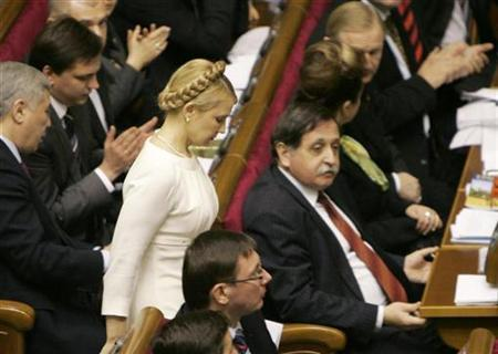 Ukraine's prime minister candidate Yulia Tymoshenko leaves a parliamentary hall before her speech in Kiev December 11, 2007. REUTERS/ Gleb Garanich