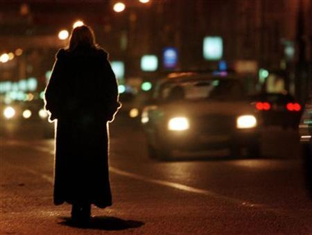 A prostitute waits for clients in the centre of Moscow early December 1, 2000. REUTERS/Sergei Teterin
