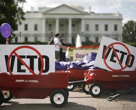 Wagons filled with petitions protesting President Bush's veto of the State Children's Health Insurance Program sit in front of the White House, October 1, 2007. Bush on Wednesday vetoed a bill expanding a popular children's health care program for the second time, angering Democrats who are locked in a fight with the administration over the budget and spending. REUTERS/Jim Young