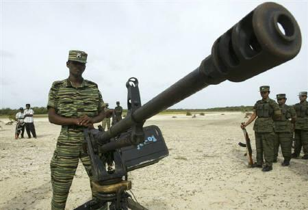 Tamil Tiger rebels stand next to a machine gun during military exercises in Kilnochchi, north of Sri Lanka in this July 13, 2007 file photo. REUTERS/Anuruddha Lokuhapuarachchi