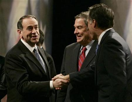 Republican Party presidential candidates (L-R) former Arkansas Governor Mike Huckabee, U.S. Rep Duncan Hunter (R-CA) and former Massachusetts Governor Mitt Romney gather on stage before their debate in Johnston, Iowa, December 12, 2007. Democratic candidates running for president can expect to get a question about the perils of free trade at nearly every campaign stop. But Republicans aren't escaping fears about globalization, either. REUTERS/Jason Reed
