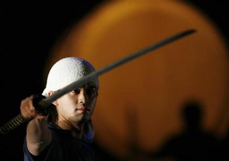 A dancer of Chanbara ''The Masters Of The Samurai Sword'' from Japan performs during a rehearsal before their second show in Budapest December 4, 2007. The government said Wednesday it would ban the sale of samurai swords because the weapons had been used in a number of serious, high-profile attacks. REUTERS/Laszlo Balogh