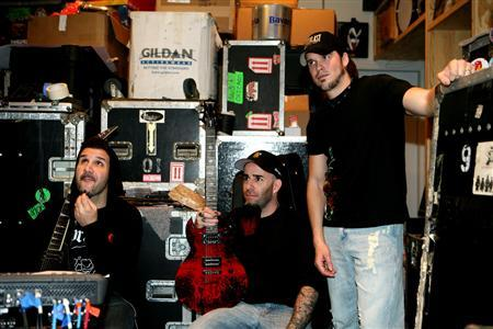 Anthrax drummer Charlie Benante, guitarist Scott Ian and new vocalist Dan Nelson, in the band's studio rehearsal space. REUTERS/Chad Lee