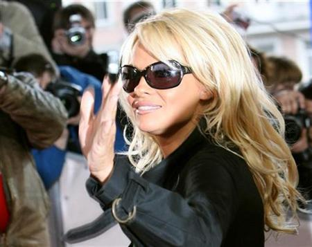 File photo shows Pamela Anderson as she arrives to host Russia's MTV Movie Awards, in Moscow April 19, 2007. Anderson slammed Mars Inc on Friday, saying she was shocked at claims the company she once helped promote funds experiments that kill animals. REUTERS/Denis Sinyakov