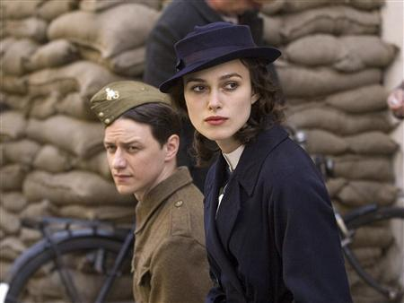 Actors James McAvoy (L) and Keira Knightley are shown in a scene from the film ''Atonement'' in this undated publicity photograph. ''Atonement'' received a total of seven Golden Globe nominations, the most for any film including best drama film, as nominations were announced in Beverly Hills, California December 13, 2007. The Golden Globe Awards, which were presented by the Hollywood Foreign Press Association, will be held in Beverly Hills January 13, 2008. REUTERS/Focus Features/Handout