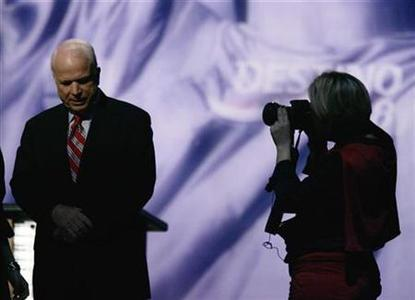 Republican presidential candidate Senator John McCain is photographed during a break in the Republican Party of Florida and Univision Spanish channel debate at the University of Miami, December 9, 2007. REUTERS/Carlos Barria