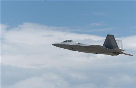 An F-22 fighter jet is seen in an undated file photo. Japan plans to postpone buying next-generation fighter aircraft to replace part of its ageing air force fleet because the United States is unwilling to export its state-of-the-art F-22 stealth fighter, a newspaper said on Monday. REUTERS/PRNewsFoto/Lockheed Martin Aeronautics Company, Rita King