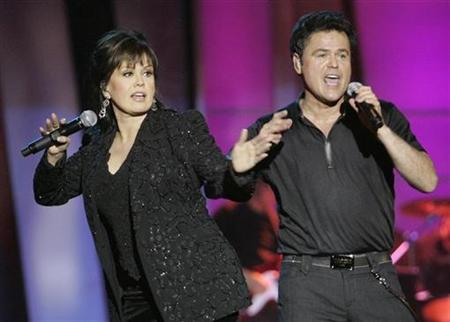 Marie Osmond and her brother Donny perform during a 50th anniversary show at the Orleans hotel-casino in Las Vegas, Nevada August 13, 2007. REUTERS/Steve Marcus