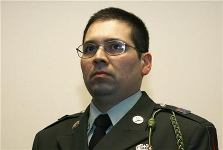 Agustin Aguayo, a mexican-born U.S. Army medic and self-described conscientious objector, attends a statement of his lawyer David Court at the Leighton Barracks in the southern German city of Wuerzburg March 6, 2007. Aguayo is on a mission to tell young Americans about the grim realities of war before they join the military. REUTERS/Alex Grimm